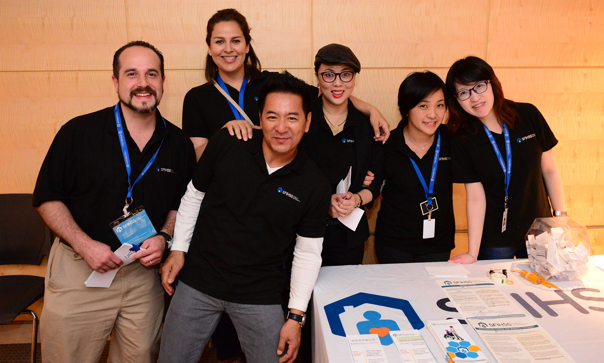 Photo of SFIHSSPA staff members grouped together at a trade show.